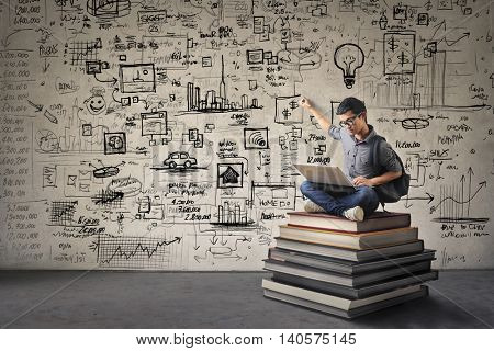 Young businessman writing schemes