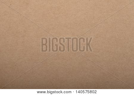 Yellow beige cardboard background paper texture macro textured