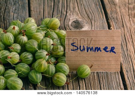 Gooseberries On A Wooden Background