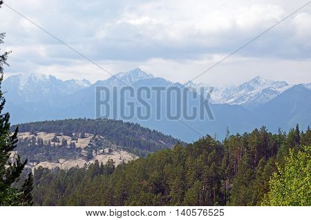 Top view on Holy Sand Mountain on a background of the East Sayan. Buryatia
