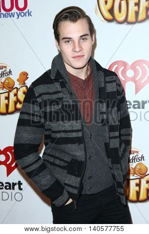 NEW YORK-DEC 12: Marcus Johns attends Z100's Jingle Ball 2014 at Madison Square Garden on December 12, 2014 in New York City.