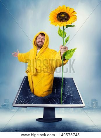 Man in the monitor holding sunflower