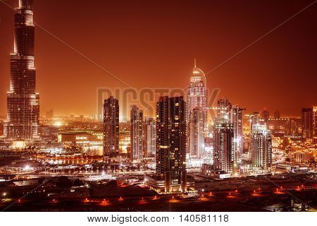 Beautiful panoramic view on Dubai downtown at night, amazing cityscape, many glowing lights in the luxury modern buildings, United Arab Emirates