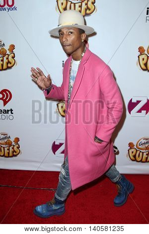 NEW YORK-DEC 12: Singer Pharrell Williams attends Z100's Jingle Ball 2014 at Madison Square Garden on December 12, 2014 in New York City.