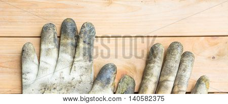 Plastic rubber glove on wood pallet background