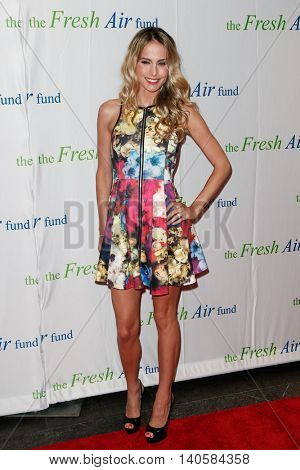 NEW YORK-MAY 29: Traci Lynn Johnson, wife of former NFL player Tiki Barber, attends the Fresh Air Fund Spring Gala Salute at Pier Sixty at Chelsea Piers on May 29, 2014 in New York City.