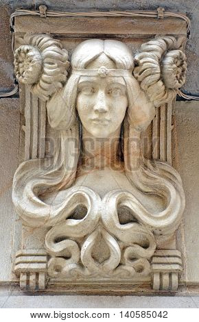 Art Nouveau Female bust stone carving on outside of building, Barcelona, Spain. Example of German Art Nouveau jugendstil artistic style