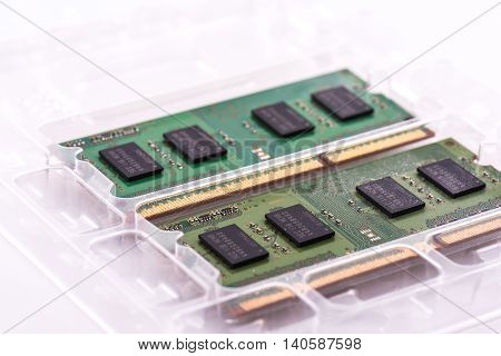 Two SODIMM memory modules in protective packaging on a white background