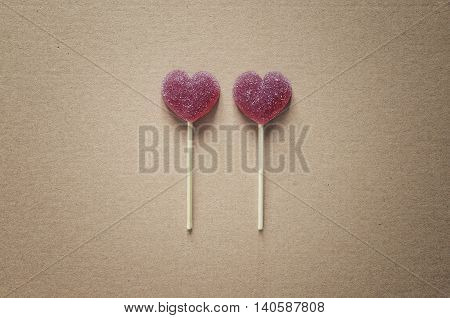 Heart shaped jelly candies on a sticks, Valentine's day concept, stylized photo