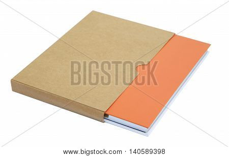 Orange notebook in brown paper case isolated on white background