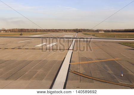 Runway marked with a black wheel marks on the runway