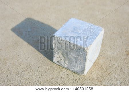 Solid cube concrete pass strength test on concrete ground.