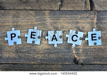 Puzzle pieces with word Peace