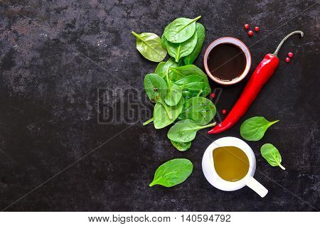 Spinach salad ingredients fresh spinach baby leaves and salad seasoning top view