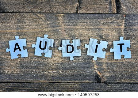 Puzzle pieces with word Audit
