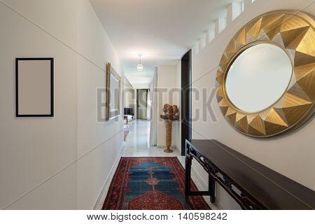 Corridor of a modern house, carpet on the floor