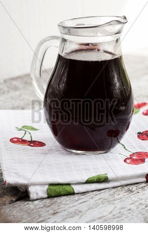 jar with cherry brandy liqueur a wine