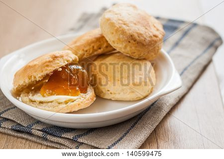 Scones With Butter And Jam On A Napkin And Bank Of Jam