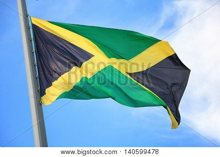 Flag of Jamaica against the blue sky