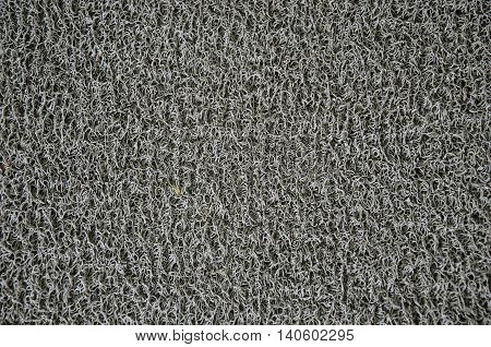 Gray synthetic fiber texture of household scrubber