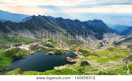 Balea Lake seen from above. Glacial lake on Transfagarasan highway in Carpathian mountains Romania in summer