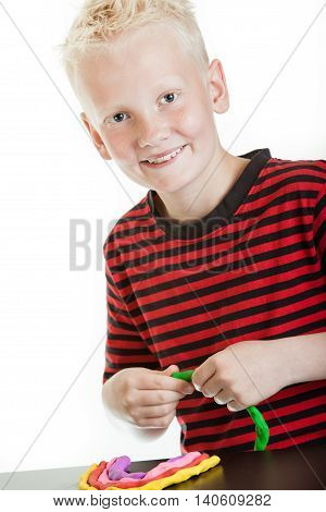 Charming Young Boy Playing With Plastic Putty