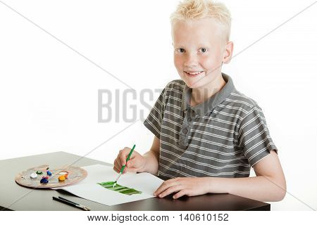 Creative Young Boy Painting With Watercolors