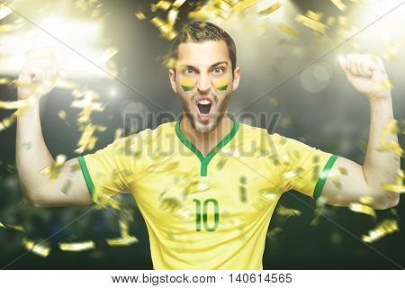 Athlete celebrating on yellow and green uniform