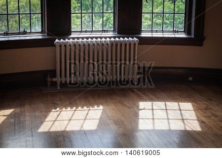 light from windows on an old wood floor in the castle rooms