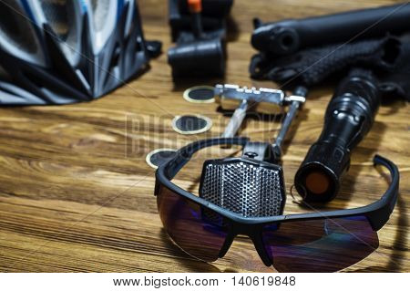 Sport equipment. Items replacements and tools for a safe cycling: Helmet gloves glasses pumps patches tire chain tool. Tools and accessories set for cycling