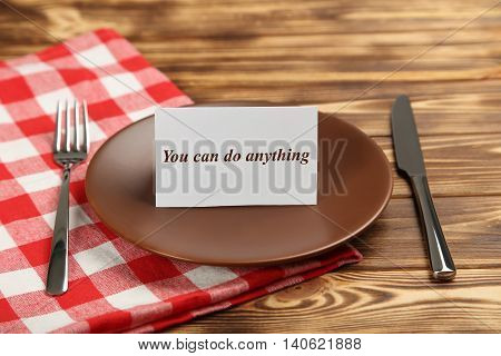 Brown plate on a brown wooden table, you can do anything