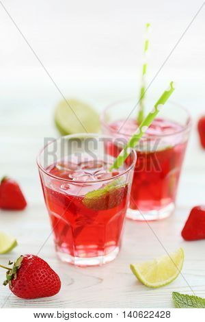Fresh Strawberry Drink In Glass With Lime On Wooden Table