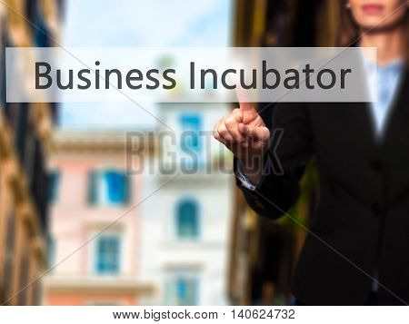 Business Incubator - Businesswoman Pressing High Tech  Modern Button On A Virtual Background