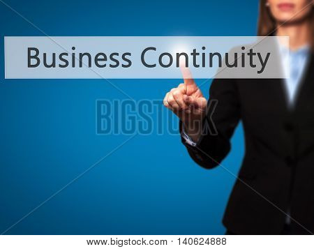 Business Continuity - Businesswoman Pressing High Tech  Modern Button On A Virtual Background