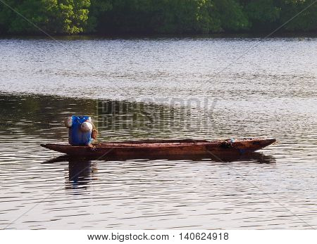 Lonesome wooden boat for fishing in sea bay in Ceylon