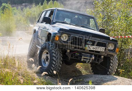 Lviv Ukraine - August 23 2015: Off-road vehicle brand Nissan overcomes the track on of sandy career near the city Lviv Ukraine.