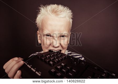 Boy With Spiky Blond Hair Wearing Striped Shirt