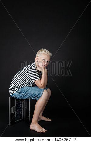 Barefoot Blond Boy Wearing Stripped Shirt Stares