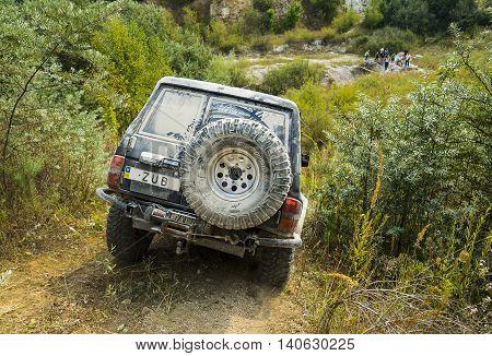 Lviv Ukraine - August 23 2015: Off-road vehicle brand Nissan overcomes the track on of sandy career near the city Lviv Ukraine.