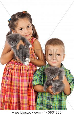 Two little kids holding a gray kittens, isolated on white