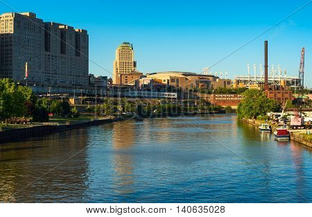 CLEVELAND OH - JUNE 17 2016: View of Quicken Loans Arena (the Q) and Progressive Field from the Cuyahoga River. The Q is the home of the NBA champion Cavaliers and hosted the Republican National Convention in July.