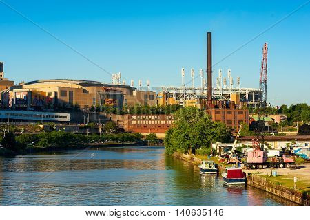 CLEVELAND OH - JUNE 17 2016: Quicken Loans Arena (the Q) from the Cuyahoga River. The Q is the home of the NBA champion Cavaliers and will host the Republican National Convention in July. The Indians' Progressive Field is at right.