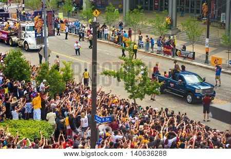 CLEVELAND OH - JUNE 22 2016: J R Smith of the Cleveland Cavaliers rides on the roof of a pickup to the cheers of crowds in the Cavs' NBA championship parade.