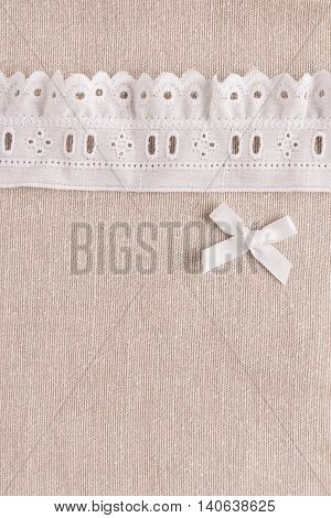 Rustic fabric for sewing lace and accessories for needlework on old wooden background. Top view with copy space.