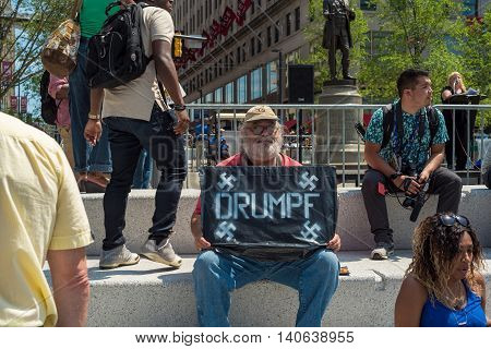CLEVELAND OH - JULY 20 2016: An anti-Trump protester holds a sign with Nazi connotations on Public Square during the Republican National Convention.