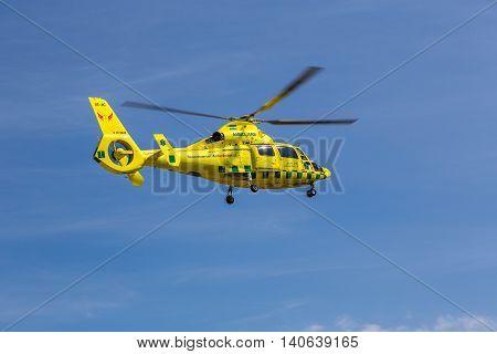 Klövsjö, Jämtland, Sweden - July 25, 2016: Ambulance helicopter in mid air. Ambulance helicopter in mid air after taking off.