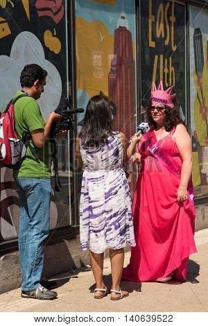 CLEVELAND OH - JULY 20 2016: A representative of Code Pink an antiwar group that infiltrates GOP conventions is interviewed on the street during the Republican National Convention