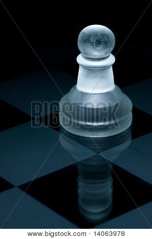 Macro Shot Of Glass Chess Pawn Against A Black Background