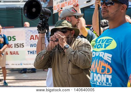 CLEVELAND OH - JULY 20 2016: A hard-core far-right street preacher harangues the crowds in an impromptu rally during the Republican National Convention.
