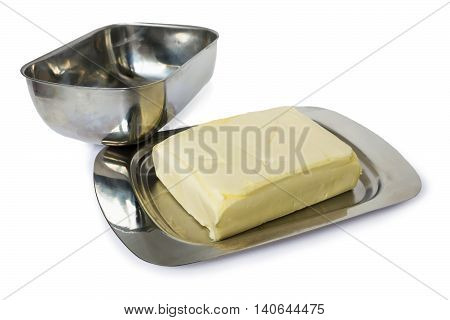 Butter in a metal flatware for butteron a white background